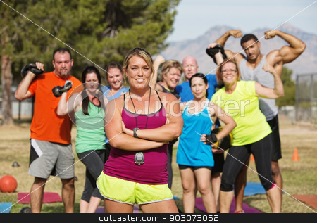 Exercise Trainer with Folded Arms stock photo, Exercise trainer with folded arms and happy group by Scott Griessel