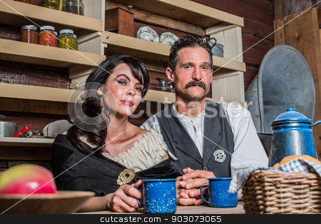 Sheriff and Woman Pose Inside House stock photo, Portrait of a sheriff and his wife inside of house by Scott Griessel