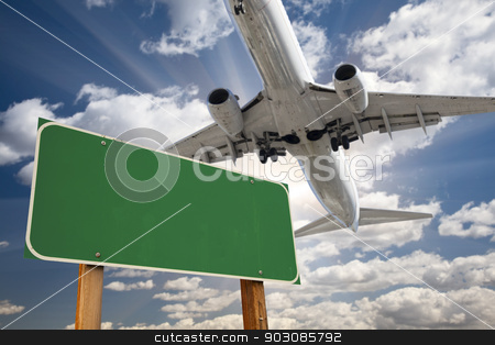 Blank Green Road Sign and Airplane Above stock photo, Blank Green Road Sign and Airplane Above with Dramatic Blue Sky and Clouds. by Andy Dean