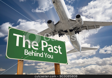 The Past Green Road Sign and Airplane Above stock photo, The Past Green Road Sign and Airplane Above with Dramatic Blue Sky and Clouds. by Andy Dean