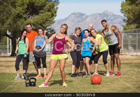Skeptical Fitness Instructor stock photo, Serious female fitness instructor pointing to group of students by Scott Griessel