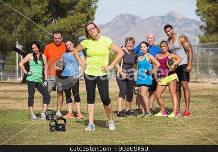 Woman Posing with Fitness Class stock photo, Serious mature woman with boot camp fitness class outdoors by Scott Griessel