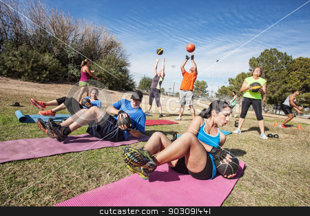 Outdoor Bootcamp Fitness Class stock photo, Group of mature adults working out in fitness class by Scott Griessel