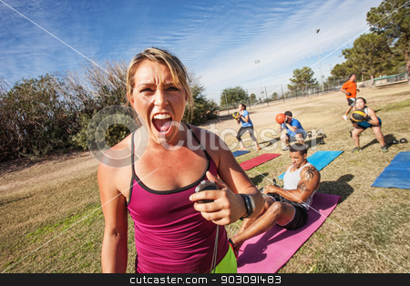 Intimidating Fitness Trainer stock photo, Intimidating boot camp fitness trainer with adult class outdoors by Scott Griessel