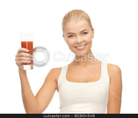 woman holding glass of tomato juice