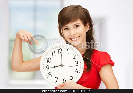teenage girl holding big clock
