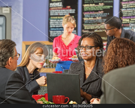 Business Executives Meeting in Bistro stock photo, Business executive showing coworkers laptop in a coffee house by Scott Griessel