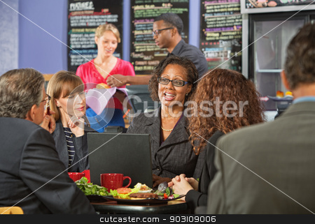 Mature Executives and Working Lunch stock photo, Attractive white collar workers meeting for a working lunch by Scott Griessel