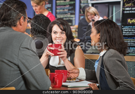 Business People in Restaurant stock photo, Attractive woman and coworkers with coffee cups in restaurant by Scott Griessel