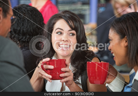 Happy Woman with Friends stock photo, Happy adult female with coffee and friends in cafe by Scott Griessel