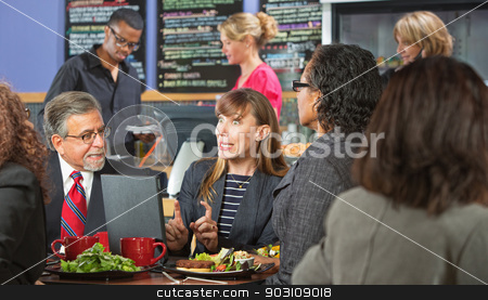 Excited Workers Meeting in Cafe stock photo, Excited business woman with coworkers and laptop in cafe by Scott Griessel