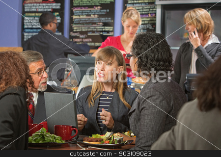 Diverse Business People Eating stock photo, Diverse group of business people eating lunch in cafeteria by Scott Griessel