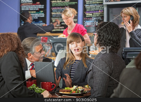 Business People Talking in Cafe stock photo, Serious adult business people meeting at indoor cafe by Scott Griessel