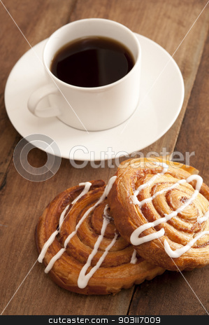 Cup of hot espresso coffee with fresh buns stock photo, Cup of hot espresso coffee with fresh spiral buns decorated with vanilla icing served on a wooden counter top by Stephen Gibson