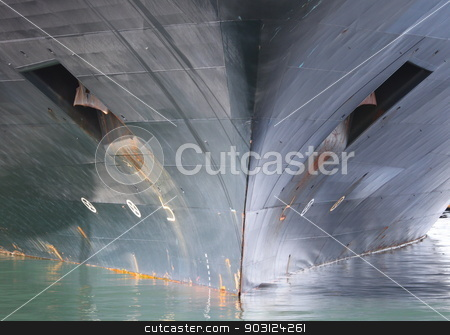 Ship Bow stock photo, Front of a ship the bow in the water. by Henrik Lehnerer