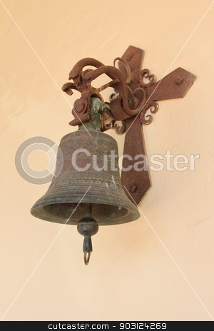 Old Bell stock photo, An old bell at the wall of a church. by Henrik Lehnerer