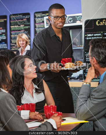Server Bringing Scones stock photo, Smiling handsome server bringing scones to business people by Scott Griessel
