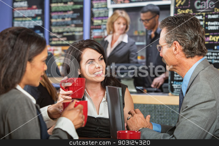Three Business People in Bistro stock photo, Three adult business people meeting at indoor cafe by Scott Griessel
