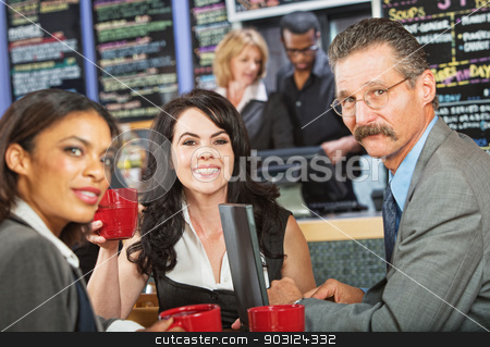 Business People on Break stock photo, Man with mustache meeting with female coworkers in cafe by Scott Griessel