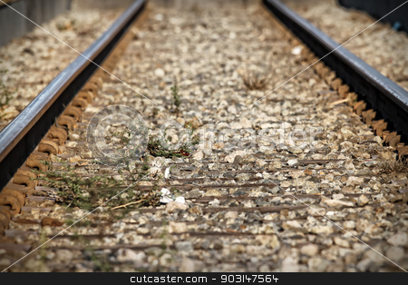 Train Tacks stock photo, Lower view of train tracks with gravel. by Henrik Lehnerer