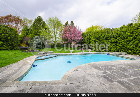 Swimming pool in backyard stock photo, Backyard with outdoor inground residential private swimming pool and stone patio by Elena Elisseeva