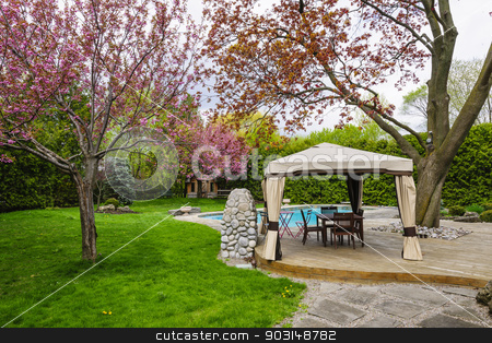 Backyard with gazebo and deck stock photo, Residential  backyard with gazebo, deck, stone patio and swimming pool by Elena Elisseeva
