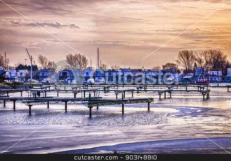 Floating homes at Bluffers park marina stock photo, Sunset behind floating homes at Bluffers park marina in Toronto, Canada.  Winter. by Elena Elisseeva