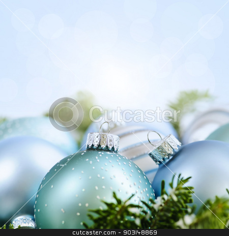 Christmas ornaments stock photo, Christmas decorations and ornaments with blue background copy space by Elena Elisseeva