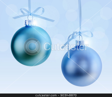 Two Christmas ornaments stock photo, Two Christmas decorations hanging on ribbons with blue background by Elena Elisseeva