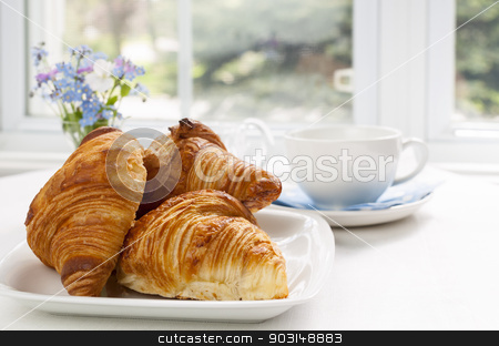 Croissants stock photo, Three fresh baked croissants on plate for breakfast by Elena Elisseeva