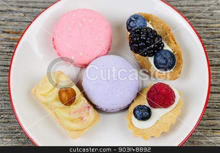 Plate of fancy desserts stock photo, Dessert plate with french macarons and pastries by Elena Elisseeva