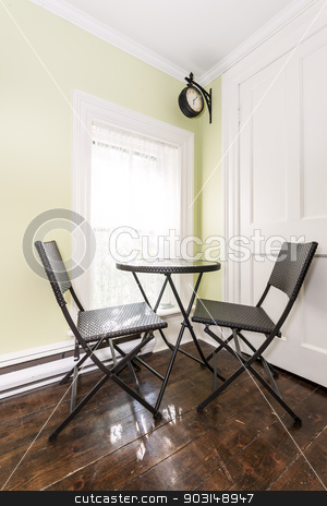 Breakfast nook in rustic house stock photo, Chairs and table in breakfast book of rustic house near bright window with old hardwood floor by Elena Elisseeva