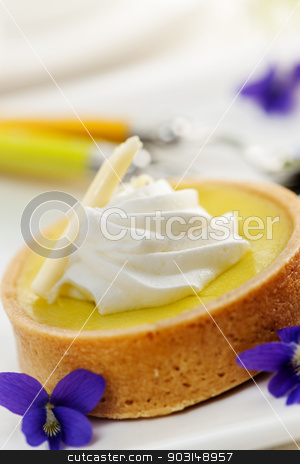 Lemon tart dessert stock photo, Fresh gourmet lemon dessert tart with edible violet flowers garnish by Elena Elisseeva