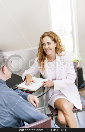 Agent meeting with client in office stock photo, Real estate agent meeting with client in business office by Elena Elisseeva
