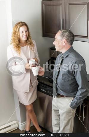 Coworkers on coffee break stock photo, Man and woman having conversation in office coffee break area by Elena Elisseeva