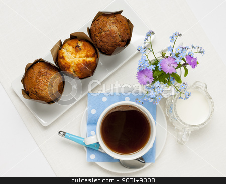 Muffins and coffee stock photo, Breakfast of three muffins and coffee from above by Elena Elisseeva