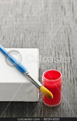 Paintbrush on canvas stock photo, Paintbrush on white blank canvas with red paint by Elena Elisseeva