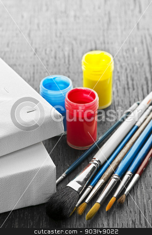 Paintbrushes with canvas stock photo, Various sizes of paintbrushes with blank canvas and paints by Elena Elisseeva