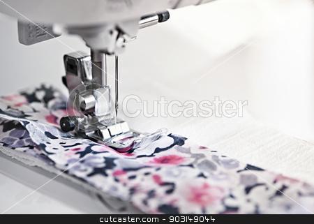 Sewing machine needle stock photo, Closeup of sewing machine needle and thread with fabric by Elena Elisseeva