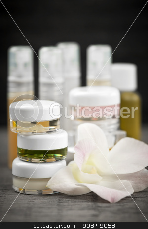 Skin care products stock photo, Various jars and bottles of skin care products with orchid flower by Elena Elisseeva
