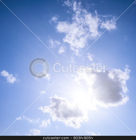 Blue sky with sun and clouds stock photo, Square blue sky background with bright sun flare shining through clouds by Elena Elisseeva