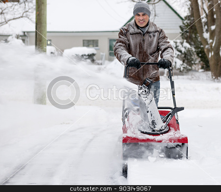 Man using snowblower in deep snow stock photo, Man using snowblower to clear deep snow on residential driveway after heavy snowfall by Elena Elisseeva