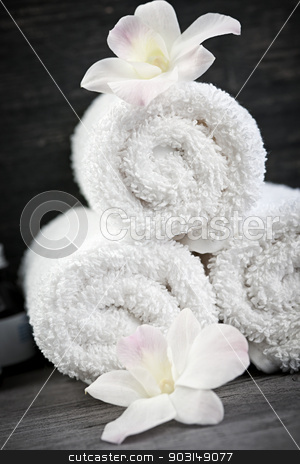 White rolled up spa towels stock photo, White rolled up spa towels with orchids flowers by Elena Elisseeva
