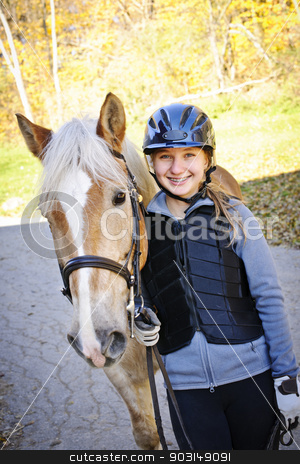 Young rider with horse stock photo, Portrait of teenage girl with horse outdoors on sunny day by Elena Elisseeva