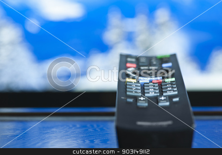 Television remote control stock photo, Television remote control closeup pointing at tv by Elena Elisseeva