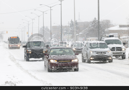 Winter driving stock photo, Cars driving on slippery road during heavy snowfall in Toronto by Elena Elisseeva