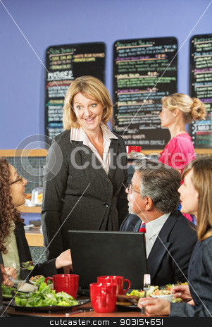 Business People in Cafe Talking stock photo, Happy customers and restaurant owner with laptop computer by Scott Griessel