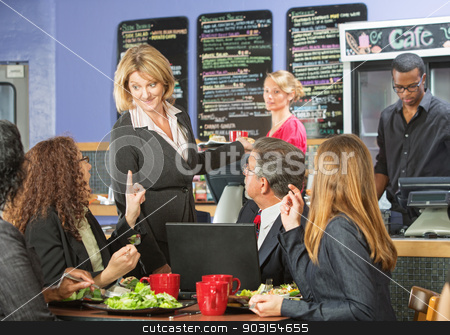 Manager Talking with Customers stock photo, Enthusiastic cafe owner talking with group of customers by Scott Griessel