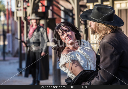 Old West Trio stock photo, Woman has been captured by old west bandit by Scott Griessel
