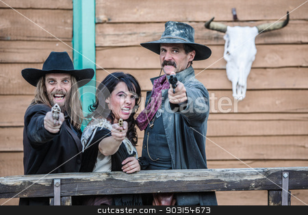 Old West Trio Yells stock photo, Old west trio screams and points guns by Scott Griessel